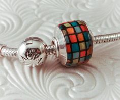 Lampwork Glass Big Hole Bead Charm Sterling Capped and Lined - Multi Color Blocks - Handmade SRA. $32.00, via Etsy.