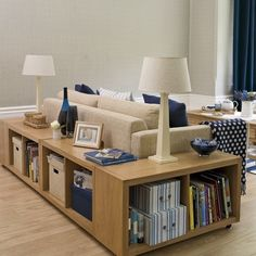 Small Spaces : Living Rooms - a little too modern for my taste, but I love the storage!