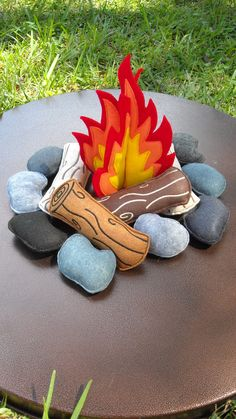 Your little one will love to play around the campfire on cold days or pretend that they are camping when it is warm outside or how about roasting some marshmallows for s mores? (Sold Separately) This felt campfire will surely have your little ones busy roasting our felt marshmallows (sold separately). Includes: Fire - measures 6 1/4 x 9 1/4. 2 separate pieces (15.87cm x 23cm) 4 Logs - measures 6-3/4 x 2-1/2 (17.15cm x 6.63cm) 8 Rocks - measure 3-1/2 x 2-1&#x2...