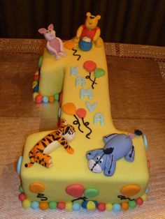 Winnie the Pooh Piglet Tigger Eeyore number one - Moist chocolate cake, chocolate butter icing filling, covered in fondant with handmade gum paste Winnie the Pooh caracters. Customer supplies image of what she wanted.