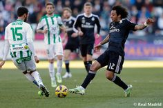 Marcelo of Real Madrid CF competes for the ball against Deivid of Córdoba FC during the La Liga match between Córdoba CF and Real Madrid CF at Estadio Nuevo Arcángel on January 24, 2015 in Cordoba, Spain.