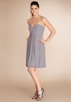 A sweetheart neckline and flirty skirt flatter everyone that wears this delicate chiffon.