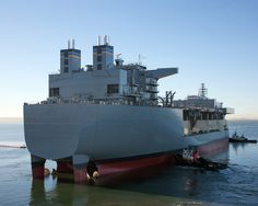 Future USNS Lewis B. Puller (MLP-3),3rd in US Navy's new Mobile Landing Platform class,launched into San Diego Bay at General Dynamics NASSCO shipyard.Puller 1st Afloat Forward Staging Base variant of class.Design adds flight deck,berthing,fuel & equipment storage,& repair spaces to MLP hull.With rotating crew of civilian & military personnel,can operate forward almost continuously,providing base of operations.