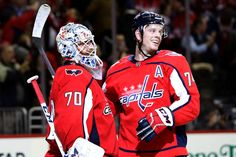 WASHINGTON, DC - DECEMBER John Carlson of the Washington Capitals celebrates the Capitals win over the Buffalo Sabres with goalie Braden Holtby at Capital One Arena on December 2018 in Washington, DC. (Photo by Rob Carr/Getty Images) Washington Capitals Hockey, Washington Dc, Braden Holtby, Nhl Games, Buffalo Sabres, Hockey Teams, All Star, The Selection, Motorcycle Jacket