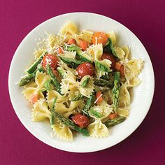 Pasta Primavera    Ingredients: olive oil, onion, garlic, cherry tomatoes, low-fat milk, salt, farfalle (bow-tie) pasta, carrots, asparagus, zucchini, basil leaves and Parmesan cheese.    Calories: 286