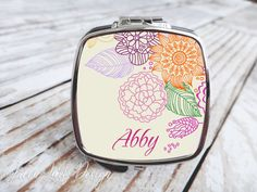 Looking for a personalized gift for your bridesmaids or any other special occasion? Our personalized compact and pocket mirrors fit the bill perfectly. They are the perfect size to slip into a pocket, purse, or desk drawer for quick makeup and hair checks. Our mirrors are also great as wedding and party souvenir gifts to hand out to guests; personalized with the happy couples initials and date. They are a lasting reminder of your special day!  Each compact mirror comes beautifully packaged…