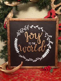 Joy to the World Wood hand lettered sign Background is black, lettering is in gold and white. Measures 12x12x2 Frame is Stained with a Rich Walnut stain and can stand alone or its ready to hang on the wall. Customizable by size or color.