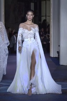 Stunning Embellished White Backless Slit Sheath Evening Maxi Dress / Evening Gown with Off Shoulder Illusion, Long Sleeves and Open Back. Couture Spring Summer 2019 by Zuhair Murad