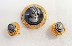 VINTAGE GOLD TONE HEMATITE CAMEO BROOCH AND EARRING SET