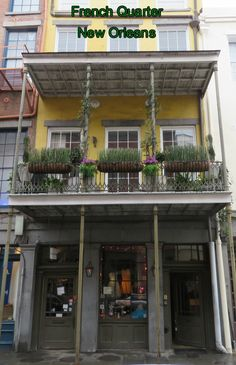Bright colors and flowers enliven the French Quarter of New Orleans, Louisiana. Usa Travel Guide, Travel Usa, Travel Guides, Travel Tips, Travel Destinations, Best States To Visit, Cool Places To Visit, American Express Rewards, States In America