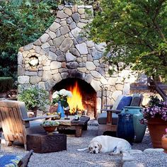 Love it!  outdoor fireplace and pea gravel