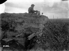 WWI, 12 Oct New Zealand signaller on a German dug-out, Gallipoli Farm, Belgium. Photograph by Henry Armytage Sanders. Spring Offensive, Battle Of Passchendaele, Global Conflict, Flanders Field, Ottoman Empire, World War I, Wwi, Great Britain, First World