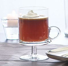 Hot Buttered Rum  | Ingredients:  3/4 cup lightly packed dark brown sugar   1/2 cup (8 Tbs.) unsalted butter, at room temperature   1 tsp. pure vanilla extract   1/2 tsp. ground cinnamon   1/4 tsp. ground cloves   1/4 tsp. freshly grated nutmeg   1/4 tsp. ground allspice   2-1/2 to 3 cups high-quality dark rum, preferably Gosling's   Whipped heavy cream for garnish