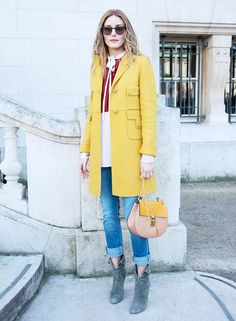 Make like Olivia Palermo and shorten the chain on your Chloé Drew shoulder strap by knotting it, and presto! It's a top-handle bag. Clever.