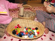 Use various loose parts and present them to your toddler in baskets to encourage fine motor skills and open ended play!