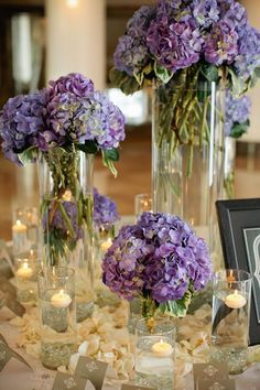 purple wedding centerpiece; Featured Photographer: Kristyn Hogan via Elizabeth Ann Designs