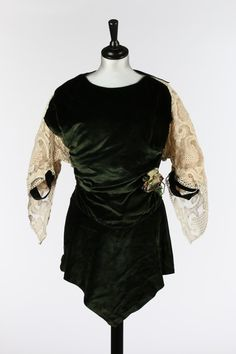 One Item | Kerry Taylor Auctions Lot No 34 : A Paquin couture green velvet tunic bodice, Winter 1912 collection. - See more at: http://kerrytaylorauctions.com/one-item/?id=34&auctionid=401#sthash.r8VQp9iE.dpuf