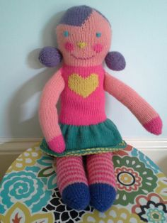 A dolly I made for my daughter. I used Patons Sock Monkey pattern as the basis and also took some ideas from pictures of those expensive BlaBla knit dolls.