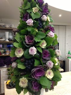 Using Kale and purple roses in a unique topiary with Paula Pryke www.duselbrillant.com