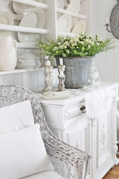 Galvanised bucket and floral arrangement on sideboard.