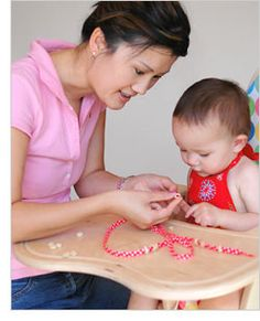 Two fun games for a 1 year old... String-Along & Package Play via BabyCenter