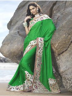 Look very stylish and elegant in this outstanding green viscos saree. The saree features excellent cut work border which highlights the look of the saree, while the body of the saree has minute buys which gives it a beautiful look. (Slight variation in color is possible)