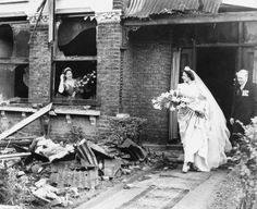 Wartime bride , leaving her parents bombed out house to go to the church with her proud dad.