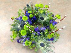 Floral ring: Blue Eryngium, Kermits, Delphinium, Bupleurum, and Pussy Willow