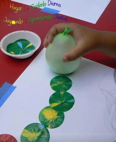 Painting fun with a balloon and mixed color paint.
