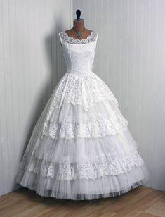 Lacy wedding dress. Love the skirt
