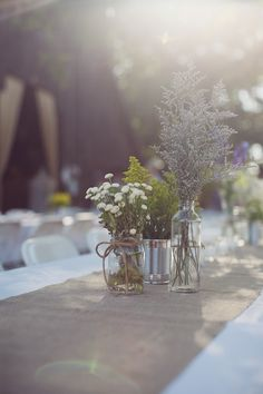 repurposed jars and tin cans make for PERFECT vases for your centerpieces!