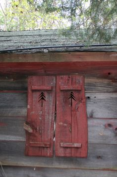 Old Red Cabin Shutters...with rustic pine tree cutouts.