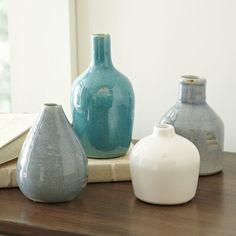 Rustic glazes in white, light blue, and turquoise make these vases stunning together as a set, as well as when used individually. Each features a unique silhouette and height to add visual interest whether filled with blooms or left bare. Set of 4.