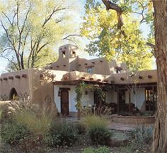Pueblo Revival architecture usually includes elements of Spanish Colonial and Mission Revival architecture styles. Its characteristics include earth-colored stucco walls with an adobelike appearance