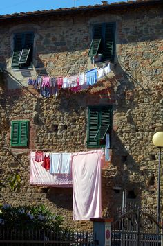 "Colorful Laundry: Two ladies worked and chatted as they ""aired"" their laundry. #travel #italy #tuscany"