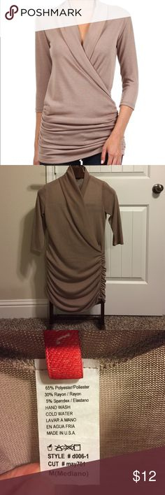 """Khaki Ruched Surplice Top Worn a couple of times. Like new condition. It's gathered design and hint of stretch add a dash of comfy-chic to your wardrobe. Size M: 31"""" long from high point of shoulder to hem. 65% polyester/ 30% rayon / 5% spandex. Tops Blouses"""