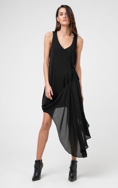 The Iris Dress is a flattering asymmetric silk and jersey mix sleeveless dress, with V-neckline and side drape. Versatile style to be worn day to night.