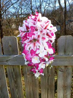 Hot pink Orchid and tiger lily cascading bouquet by DressMyWedding