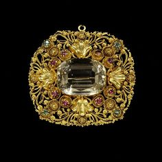 Cannetille brooch set with a citrine, emeralds and rubies, owned by Jane Morris, European, 1820-1830, Victoria and Albert Museum, London.
