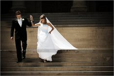 Michigan Wedding Photographers  www.ArisingImages.com  bride and groom photography on stone staircase