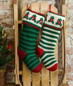 Holly & Berry Stockings  Make a green on green version or a green and white version. Both are truly special. The accents take these from an ordinary stocking and transform them into crocheted masterpieces.