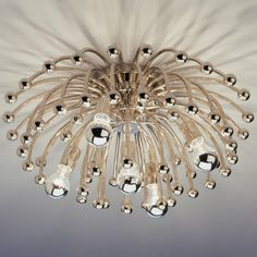 """anemone ceiling lamp $525  large: diameter 23"""" x 12.5"""" deep approx 30lbs (additional support may be required) • small: diameter 13"""" x 7"""" deep approx 10lbs • large anemone uses 5 - 60 watt E26 silver capped bulbs (not included), small anemone uses 1 - 60 watt E26 silver capped bulb (not included)"""