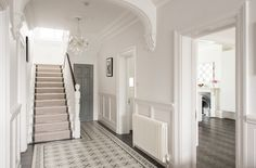 Beneath a sparkling chandelier, the impressive entrance hall features a floor tiled in Fired Earth 'Patisserie' tiles Victorian Hallway, Victorian Townhouse, Victorian Homes, Hall Tiles, Tiled Hallway, Edwardian Haus, Hall Flooring, Flur Design, Hallway Designs