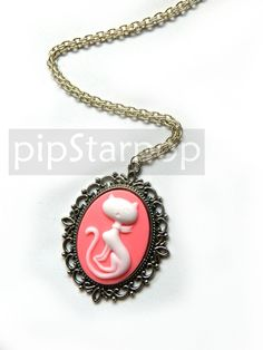 Sassy Cat Victorian Cameo Pendant (Pink) Gothic lolita fashion and Neo Classical Jewelry. $12.00, via Etsy.
