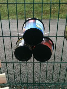 Plastic buckets turned into outdoor drums from: I'm a teacher, get me OUTSIDE here!: Outdoor Music Wall