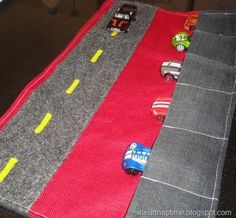 Cute craft idea to make a fabric road play map to occupy the kids when traveling.