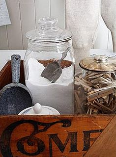 Love having powdered soap in air tight container w/scoop and all gathered in old wooden box. Great for organizing small spaces.