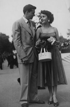 Elizabeth Taylor with fiancé Conrad Hilton at the Auteuil Racecourse steeplechase in Paris, France, June 1950.