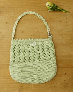 crochet purse - add a longer handle and you'd have a little girls church purse