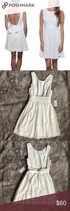 • ivy / white eyelet dress • • adorable eyelet dress  • has pockets  • ties in back  🦋 FAST SHIPPER! SAME DAY / NEXT DAY SHIPPING GUARANTEE! 🦋  I ♥️ offers! Use the button to make an offer!   ⭐️⭐️⭐️⭐️⭐️ rated     Leave a comment below with any questions!! Quiksilver Dresses Mini